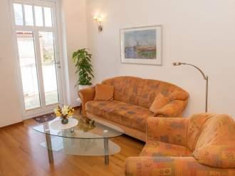 Gästehaus Muhl - Ferienwohnung in Fehmarn, Ostsee - Wohnzimmer Wohnung 1