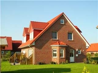 Nordseefehs. Sonne+Leuchtturm - Ferienhaus in Krummhörn-Hamswehrum