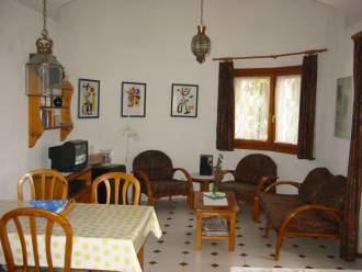 denia-pool - Ferienhaus - Wohnzimmer mit Essplatz