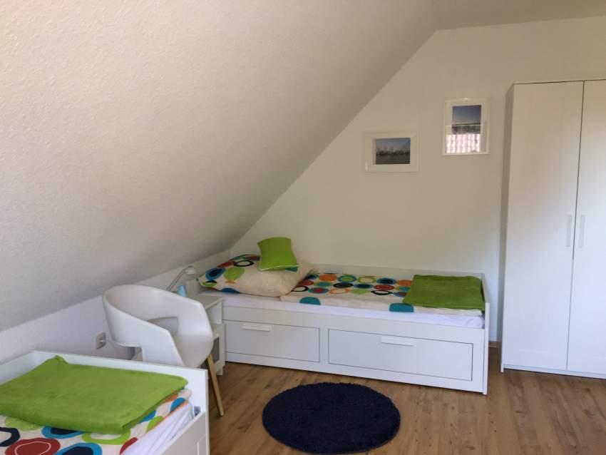 Schlafzimmer mit 2 getrennten Betten